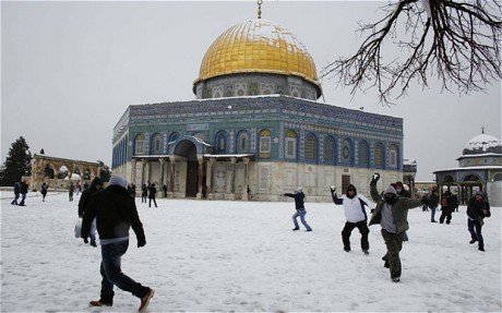 """Snowball fights in front of the Dome of the Rock in Jerusalem"" Photo: REUTERS"