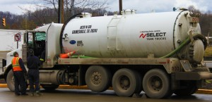 "Photo by Mark William Branciaroli for The Times""Tanker trucks like these in Buckhannon, W.Va., haul potentially radioactive brine from frack sites."""