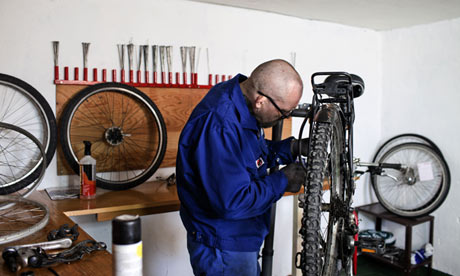 """An inmate repairs a bike."" Photograph: Marco Di LauroSource: The Guardian"