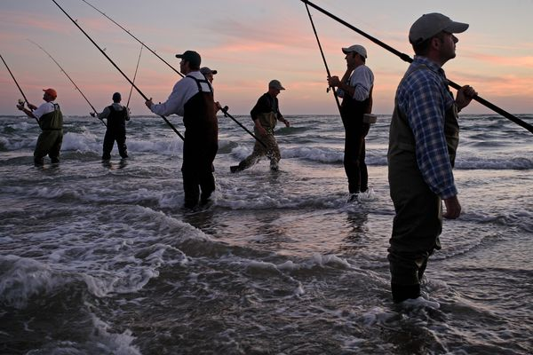 """Surf fishermen try their luck for bluefish off Cape Hatteras, North Carolina.""  Photograph by Tyrone Turner, National Geographic"