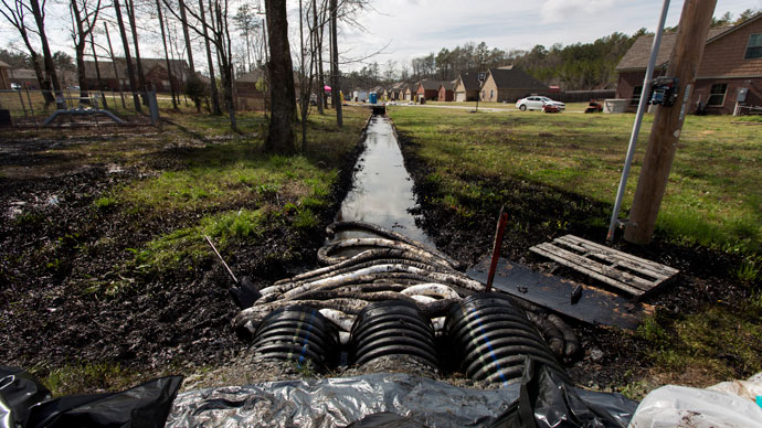 Spilled crude oil is seen in a drainage ditch near Starlite Road in Mayflower, Arkansas March 31, 2013 (Reuters / Jacob Slaton)